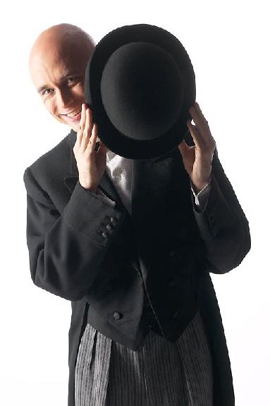 man hiding behind hat